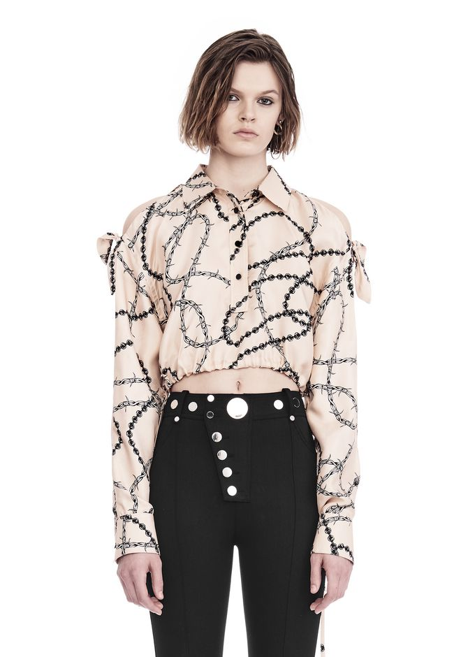ALEXANDER WANG slrtwtp CROPPED BLOUSE WITH SLIT SHOULDERS AND BARBED WIRE PRINT