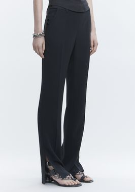 TROUSERS WITH SIDE SNAP CLOSURE